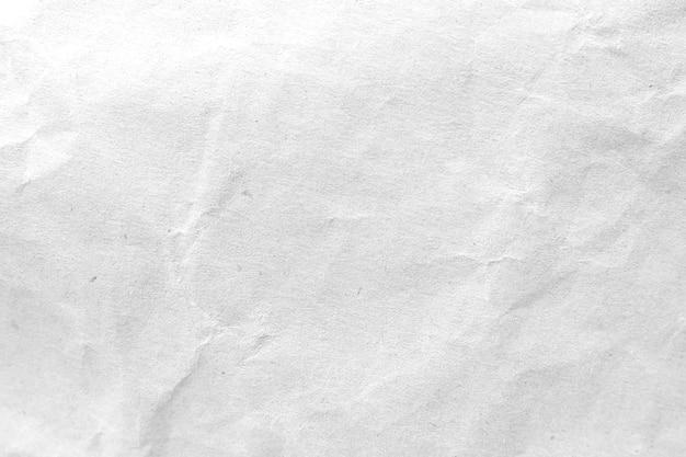Weißer zerknitterter papierbeschaffenheitshintergrund. nahansicht.