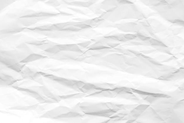 Weißer zerknitterter papierbeschaffenheitshintergrund. reinigen sie das weiße papier. draufsicht.