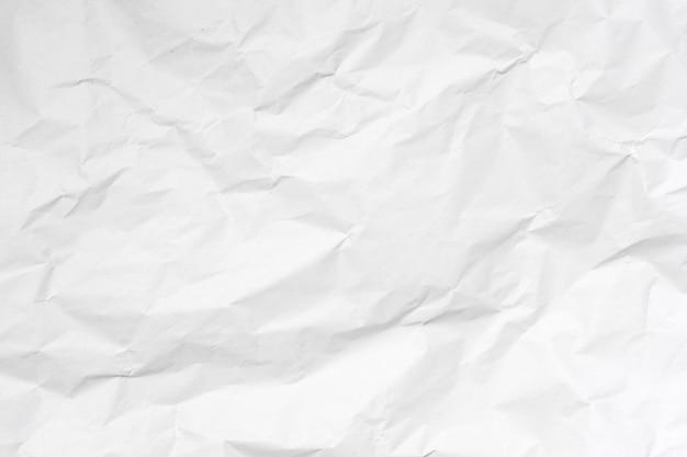 Weißer zerknitterter papierbeschaffenheitshintergrund.