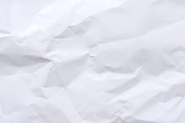 Weißer zerknitterter papierhintergrund und -beschaffenheit