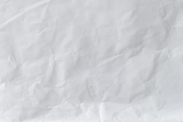 Weißer zerknitterter papierhintergrund
