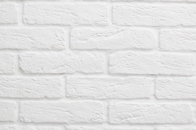 Weißer ziegelsteinhintergrund. gipsfliese, nachgemachter ziegelstein