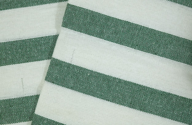 Weißes baumwollgewebe mit grünem streifen-muster-hintergrund
