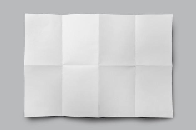 Weißes gefaltetes papier lokalisiert auf grauem hintergrund
