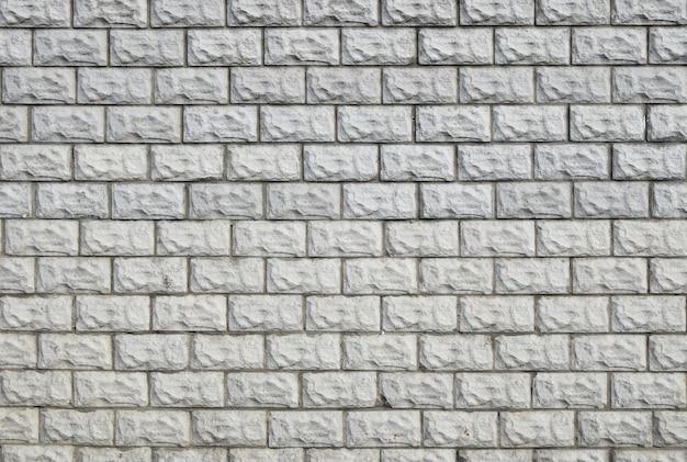 Weißes gemaltes ziegelsteinfliesenwandhintergrund-texturmuster; nahansicht