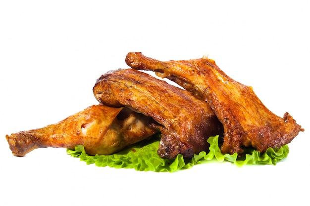 Weißes hintergrundisolat des hühnerschenkelgrills
