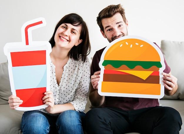 Weißes paar mit essen-symbol