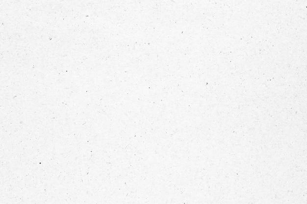 Weißes papier oder pappbeschaffenheit mit schwarzem fleckhintergrund.