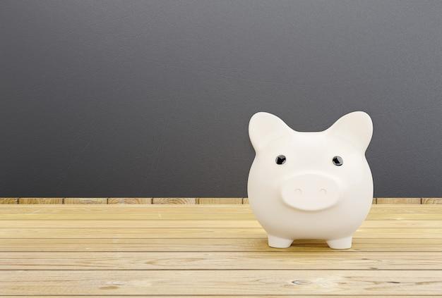 Weißes sparschwein auf hölzernem hintergrund mit geldsparkonzept.