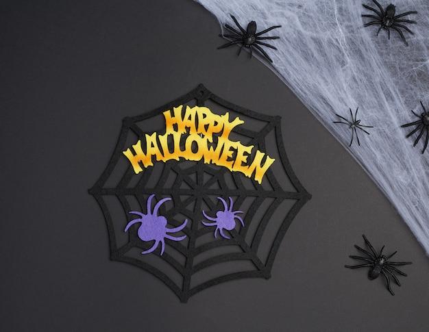 Weißes spinnennetz mit schwarzen spinnen