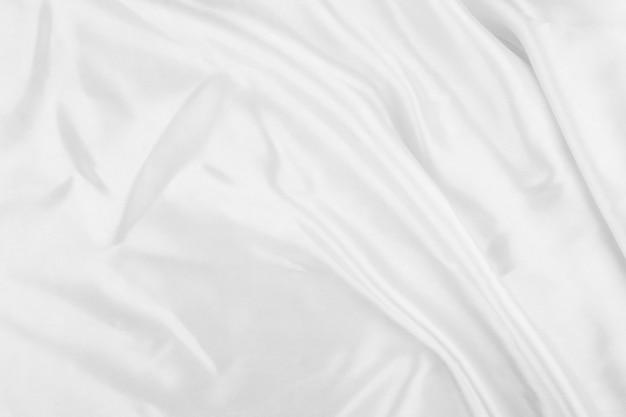Weißes tuch hintergrundzusammenfassung mit weichen wellen, nahaufnahmetextur des tuches