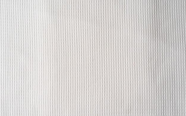 Weißes waffeltuch aus baumwolle, serviette. schließen sie herauf bild des waffeltuchs. hintergrundbild, textur für hintergrund- oder designverwendung mit kopierraum