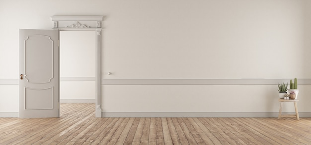 Weißes wohnzimmer im klassischen stil mit offener tür