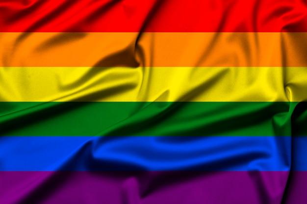 Wellenförmige lgbtqi- oder lgbt-flagge als heller regenbogenhintergrund. gay-pride-symbol.