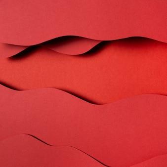 Wellenförmige rote papierschichten