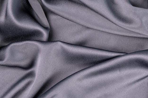 Wellenförmiger gewellter grauer blauer lila lila seidensatinstoff abstrakter hintergrund