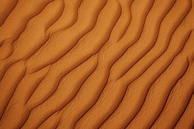 Wellige sandwüstenbeschaffenheit der nahaufnahme. von oben betrachten