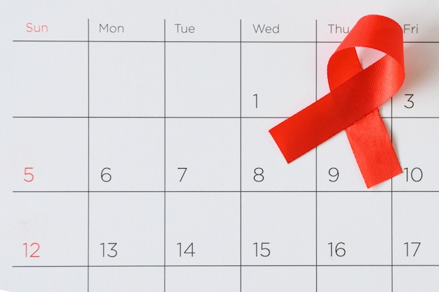 Welt-aids-tag-konzept, rotes band das datum 1. dezember