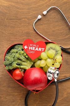 Weltherz-tageskonzept mit gesundem essen