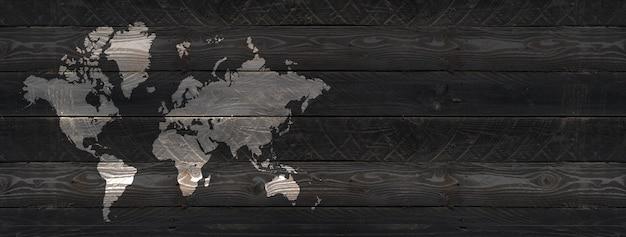 Weltkarte auf schwarzem holzwandhintergrund isoliert.