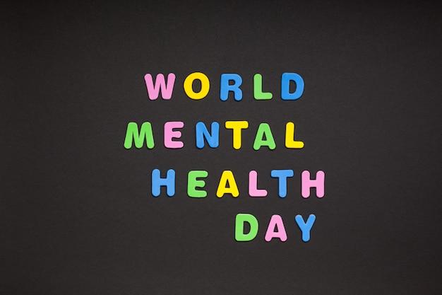Welttag der psychischen gesundheit schreiben auf schwarzem papier