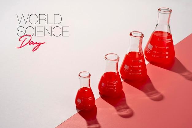 Weltwissenschaftstag-arrangement mit chemieröhrchen