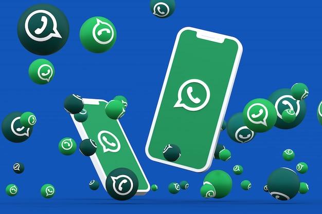Whatsapp-symbol auf dem bildschirm smartphone oder handy und whatsapp-reaktionen
