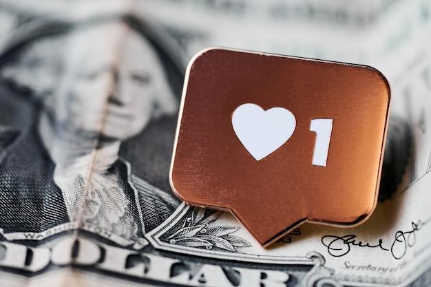 Wie herzsymbol auf dollar. wie zeichenknopf, symbol mit herz und einer ziffer. kaufen sie follower für social media network marketing. günstiges preiskonzept.