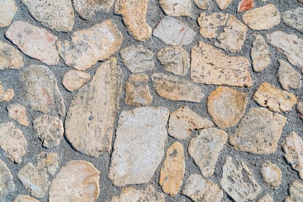 Wilder steinpflasterboden unregelmäßige formen