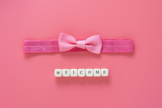 Willkommen für baby, stirnband und bogen. babypartykonzept