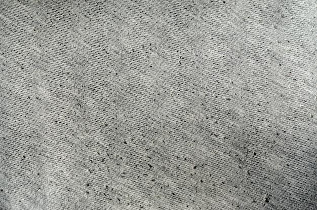 Wirkliches graues gestrick der heidekraut hergestellt aus synthetischen fasern maserte hintergrund