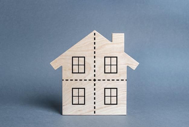 Wohngebäude durch eine gepunktete linie in vier gleiche teile geteilt. scheidung-konzept