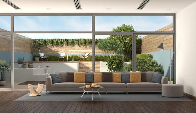 Wohnzimmer einer modernen villa mit garten auf hintergrund