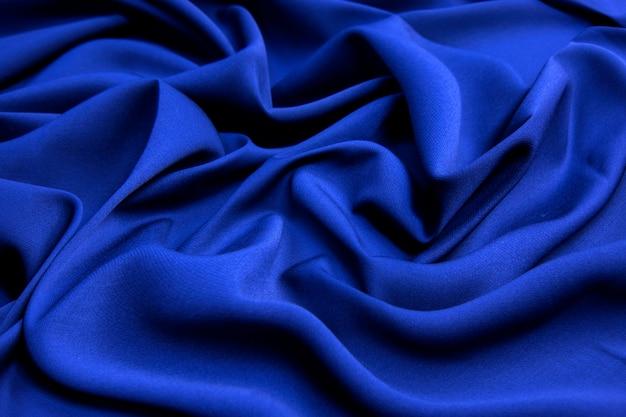 Wollstoff. farbe schwarz und blau. textur, hintergrund, muster.