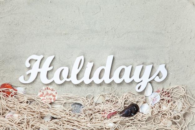 Word holidays und netz mit muscheln
