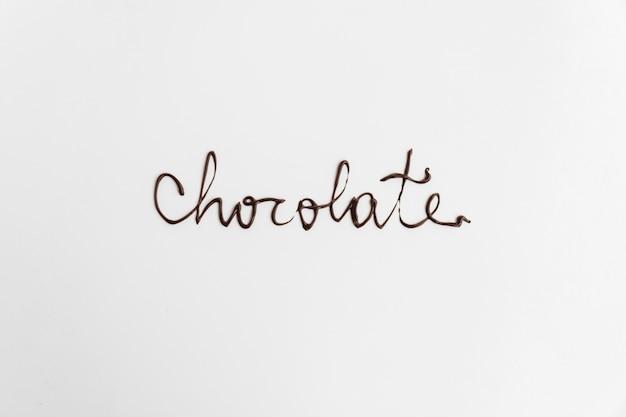 Wortschokolade geschrieben durch geschmolzene schokolade