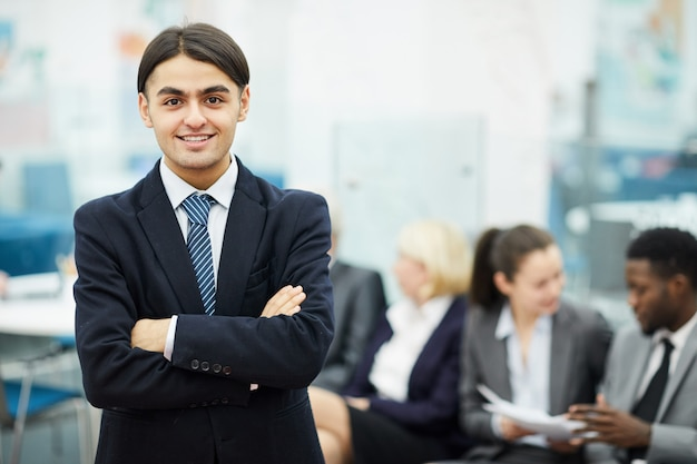 Young businessmn posing