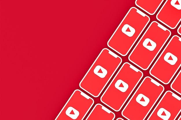 Youtube-logo auf bildschirmen des smartphones in 3d-rendering