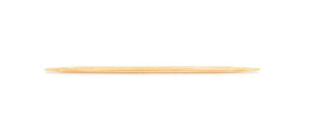 Zahnstocher aus holz auf weißem wandisolat