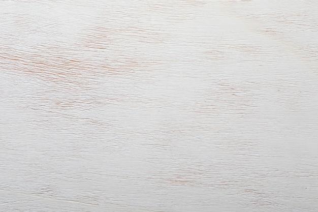 Zarte textur des natürlichen holztischs. verkäufe werden geschätzt. in hellen farben, beige und weiß. sicht von oben. platz, um hier ihren eigenen text einzufügen.
