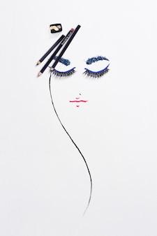 Zeichnen mit make-up-produkten auf papier.