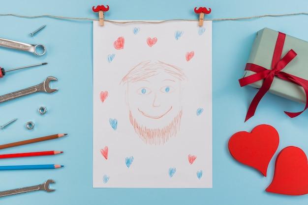Zeichnung des mannes mit werkzeugen und geschenk
