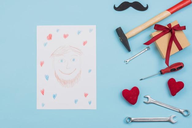 Zeichnung des mannes mit werkzeugen und geschenkbox