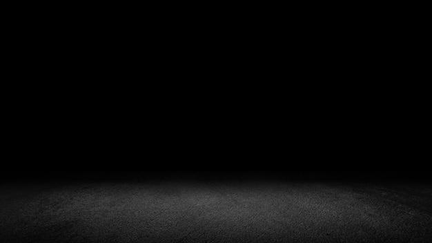 Zementieren sie bodenhintergrund auf studioraum und scheinwerferlicht. zwischen dunkelheit