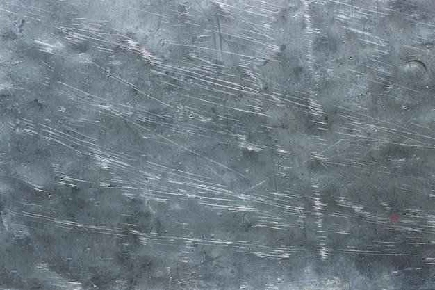 Zerkleinertes eisen, textur aus abgenutztem metall. edelstahlschablone für design