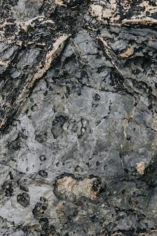 Zerklüfteter steinoberflächenbeschaffenheitshintergrund