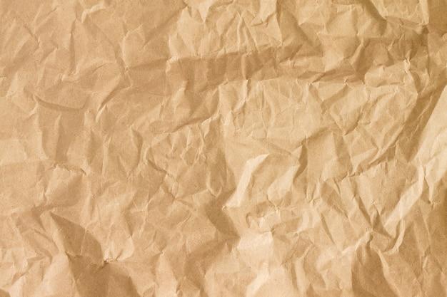 Zerknitterte goldpapierbeschaffenheit. brown zerknittertes papier