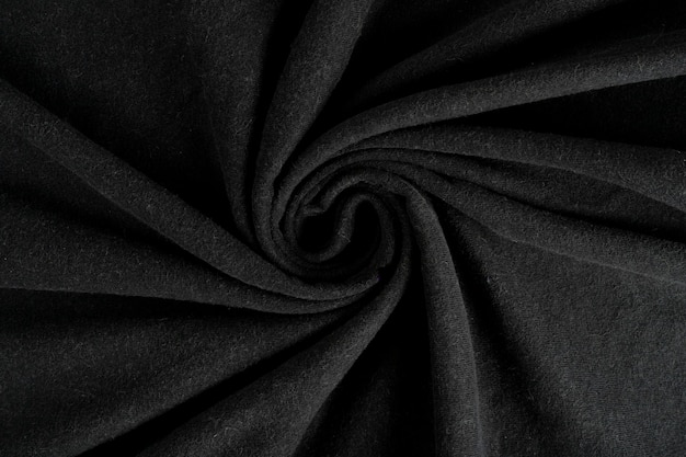 Zerknitterte leinenstoff textur. faltiges textil. dunkles schwarz.