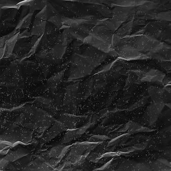 Zerknitterte schwarze papierbeschaffenheit