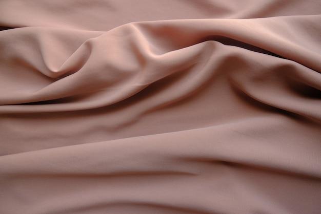 Zerknitterte stoffstruktur in hellbrauner farbe